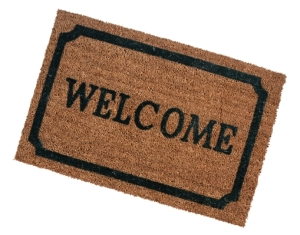Doormat with the word welcome printed on it.